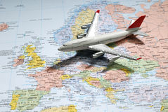Model of a passenger aircraft on Europe Map stock photography