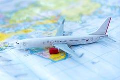 Model of a passenger aircraft. On a map Stock Photos