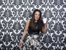Model Pauses to Drink Coffee and Laugh Stock Photography