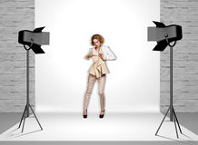 Model in photo studio with spotlights Royalty Free Stock Image
