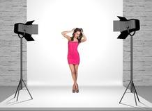 Model in photo studio with spotlights Stock Image