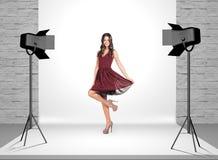 Model in photo studio with spotlights Stock Photo