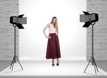 Model in photo studio with spotlights Royalty Free Stock Photos