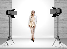 Model in photo studio with spotlights Royalty Free Stock Photo