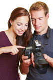 Model and photographer checking Stock Images