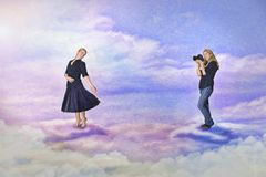 Model and photographer. Working in the sky royalty free illustration