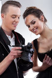 Model and photographer watching photos Royalty Free Stock Photos