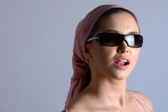 Model with pink dress and sunglasses Stock Image