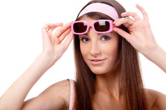 Model in pink sun-glasses Royalty Free Stock Photography