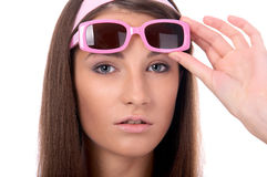 Model in pink sun-glasses Stock Images