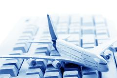 Model plane on computer keyboard Royalty Free Stock Photography
