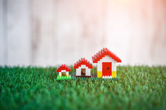 Model of plastic house building with grass floor Stock Image