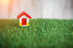 Model of plastic house building on grass.jpg. Model of plastic house building, loan, real estate or buying a new home concept.with copy space Stock Photos