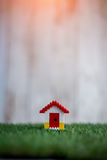 Model of plastic house building on grass.jpg Stock Photography