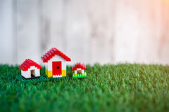 Model of plastic house building with grass texture Royalty Free Stock Photography