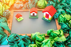 Model of plastic house building with trash paper Stock Photo