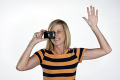 Model with Point and Shoot Camera. Blond model holding a point and shoot camera Royalty Free Stock Images