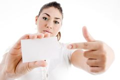 Model pointing towards business card Royalty Free Stock Image