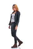 Model pose in leather jacket while walking in studio and looking. Cute sexy model pose in leather jacket while walking in studio and looking at the camera Stock Photos