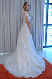 A model poses at the Henry Roth Bridal Sprng 2016 Collection presentation. NEW YORK, NY - APRIL 22: A model poses at the Henry Roth Bridal Sprng 2016 Collection Stock Photo