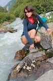 Model poses in a mountain stream Stock Image