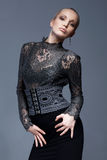 Model Posing. Portrait of a beautiful model in black, lace blouse, posing Royalty Free Stock Photography