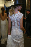 A model posing backstage during the Claire Pettibone Bridal Spring/Summer 2016 Runway Show. NEW YORK, NY - APRIL 17: A model posing backstage during the Claire royalty free stock photo
