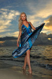 Model posing in beach dress at early morning sunrise stock photography