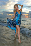 Model posing in beach dress at early morning sunrise stock images