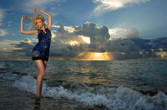 Model posing in beach dress at early morning sunrise Royalty Free Stock Photo