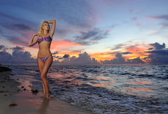 Model posing in bikini at early morning sunrise Royalty Free Stock Images