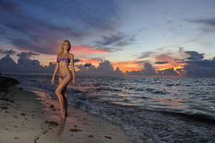 Model posing in bikini at early morning sunrise Stock Images