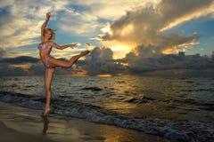 Model posing in bikini at early morning sunrise Stock Image