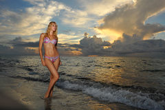 Model posing in bikini at early morning sunrise Stock Photography