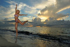Model posing in bikini at early morning sunrise Stock Photo