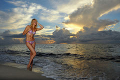 Model posing in bikini at early morning sunrise Stock Photo