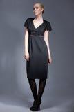 Model Posing in Black Evening Dress. Portrait of a beautiful model dressed in black, vintage dress, posing Stock Photos