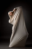 Model posing in cocoon as butterfly transformed Stock Photos