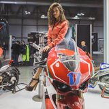 Model posing at EICMA 2014 in Milan, Italy Stock Photos