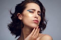 Model posing with eyepads Royalty Free Stock Image
