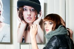 Model posing in front of a showcase Royalty Free Stock Photo