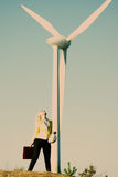 Model posing in front of wind power generator Stock Images