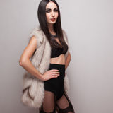 Model posing in fur vest Royalty Free Stock Images