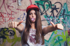 Model posing on graffiti background Stock Photo