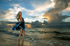 Free Model Posing In Beach Dress At Early Morning Sunrise Stock Photo - 43304360