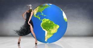 Model posing near big earth ball Stock Images