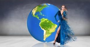 Model  posing near big earth ball Royalty Free Stock Photo