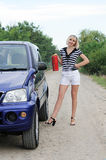 Model posing near the car Royalty Free Stock Photography