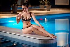 Model posing near pool Stock Photos