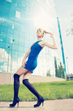 Model posing outside on high heels Stock Photo